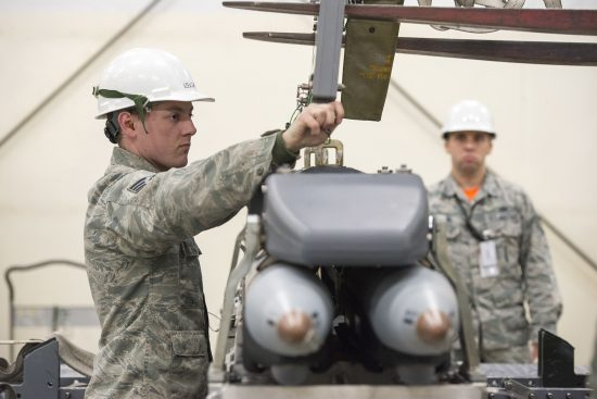 3rd Munitions Squadron Airmen practice handling small diameter bombs