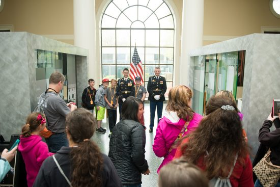 Members of The Old Guard pose for photographs in the Welcome Center of Arlington National Cemetery