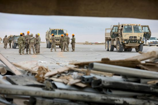 Soldiers, Airmen and contractors clearing debris after Al-Asad Airbase missile attack