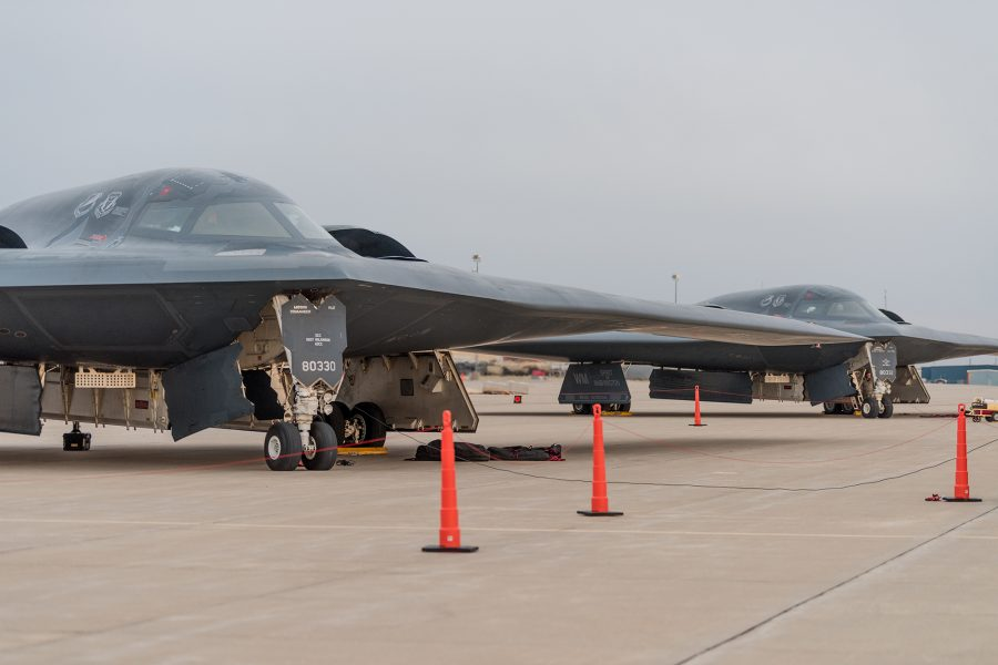 Two B-2 Spirit Stealth Bombers from Whiteman AFB sit on the flight line