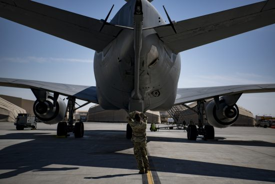 Deployed KC-10 refuels F-15 Strike Eagles