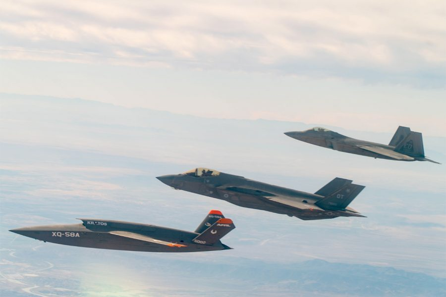A U.S. Air Force F-22 Raptor and F-35A Lightning II fly in formation with the XQ-58A Valkyrie low-cost unmanned aerial vehicle over the U.S. Army Yuma Proving Ground testing range, Ariz., during a series of tests Dec. 9, 2020. This integrated test follows a series of gatewayONE ground tests that began during the inaugural Department of the Air Force on-ramp last year in December. Courtesy photo.
