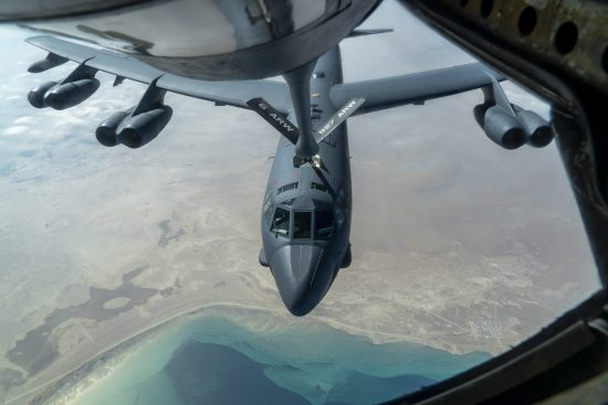 B-52 Stratofortress and F-16 Fighting Falcon fly over U.S. Central Command