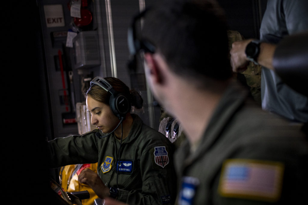 Boom operators Airman 1st Class Crissy Hall and Staff Sgt. Ryan Edsall, both with the 344th Air Refueling Squadron, operate a KC-46's refueling system during a May 25 flight.